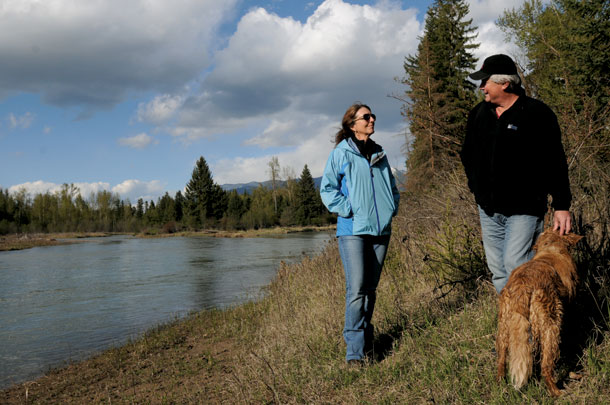 The Smiths and their dog enjoy their Flathead riverbank legacy.